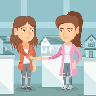 Real estate agent and client shaking hands.