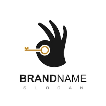 Real estate logo design with hand and key symbol