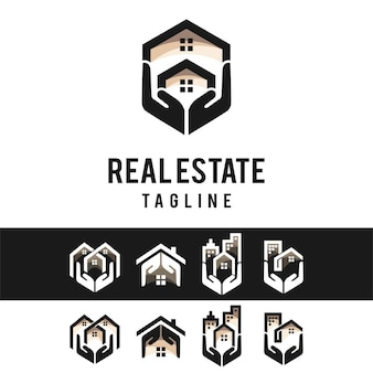 Логотип недвижимости с концепцией руки