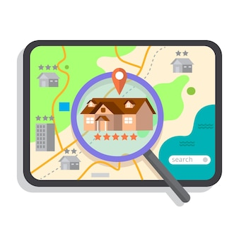Ricerca immobiliare con tablet e lente d'ingrandimento
