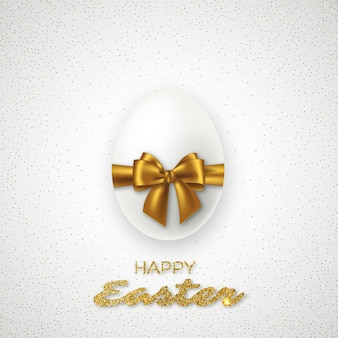 Realistic 3d easter egg with golden bow. luxury festive holiday.
