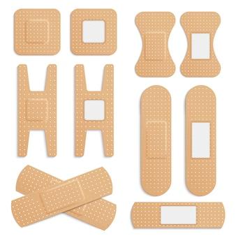 Реалистичные липкие эластичные медицинские пластыри, набор эластичных медицинских пластырей бинтов, изолированных на белом фоне.