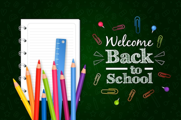 Realistic back to school background with pencils and notebook