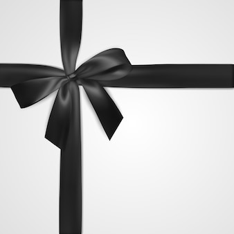 Realistic black bow with ribbon isolated on white