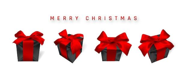 白で隔離の赤い弓と現実的な黒のクリスマスギフトボックス
