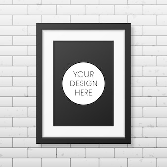 Realistic black frame a4 on the brick wall