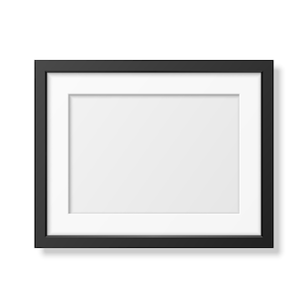 Realistic black frame a4 isolated on white.