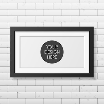 Realistic black frame  on the brick wall