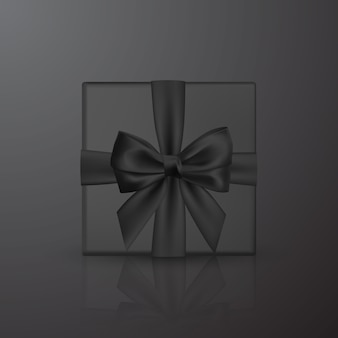 黒のリボンとリボンが付いたリアルな黒のギフトボックス。装飾ギフト、挨拶、休日の要素。