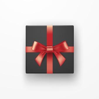 赤いリボンが付いている現実的な黒いギフトボックス