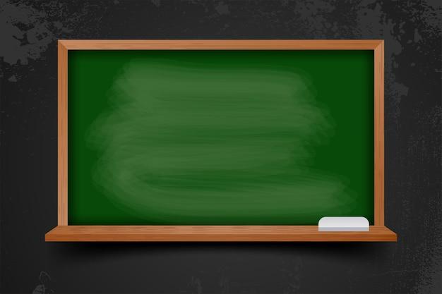 Realistic blank chalkboard in wooden frame