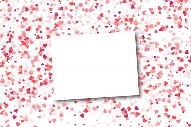 白い背景の上の心紙吹雪と現実的な空白のグリーティングカード。幸せなバレンタインデーのコンセプトです。