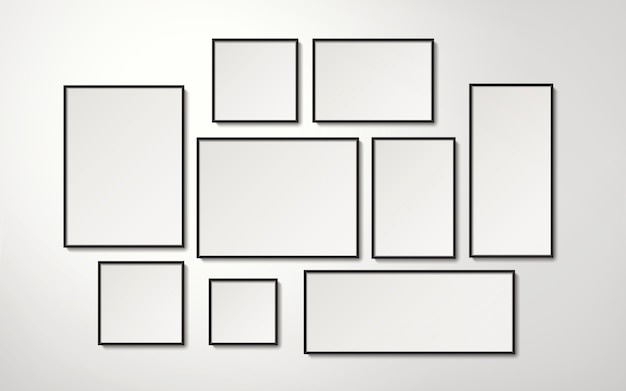 Realistic blank picture frames collection hanging on the wall, 3d illustration Premium Vector