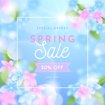 Realistic blurred spring sale illustration with flowers