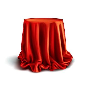 Scatola realistica ricoperta di panno di seta rosso isolato su sfondo bianco.