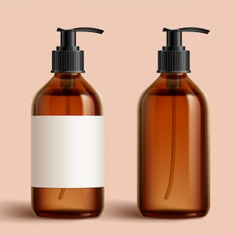 Realistic brown cosmetic bottles on peach pink background one with white blank label