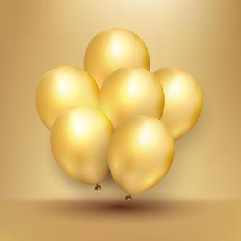 飛んでいる光沢のある金の風船のリアルな束