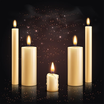 Realistic candles with set of different candles with flame and light particles on dark surface illustration Premium Vector