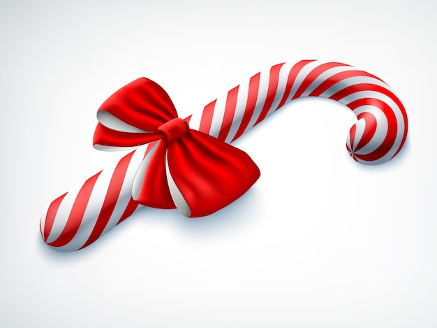 Realistic candy cane decorated with red bow on white