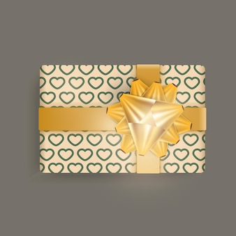 Realistic champagne color gift box with hearts pattern, gold ribbons and bow.
