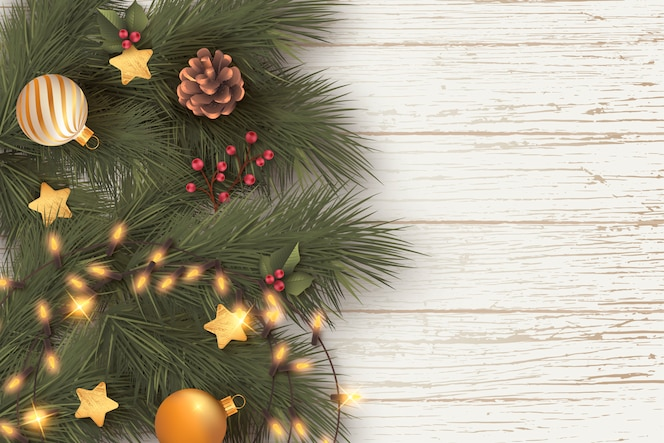 Realistic christmas background with leaves and lights