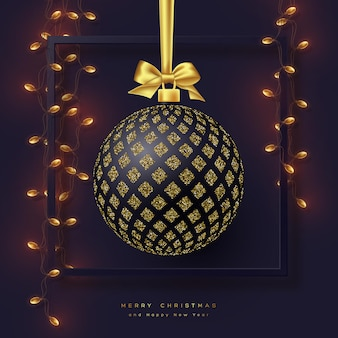 Realistic christmas bauble with golden bow, frame and garland. decorative elements for christmas holiday. dark background. vector illustration.