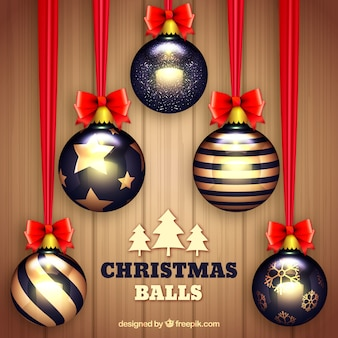 Realistic christmas baubles in black and golden