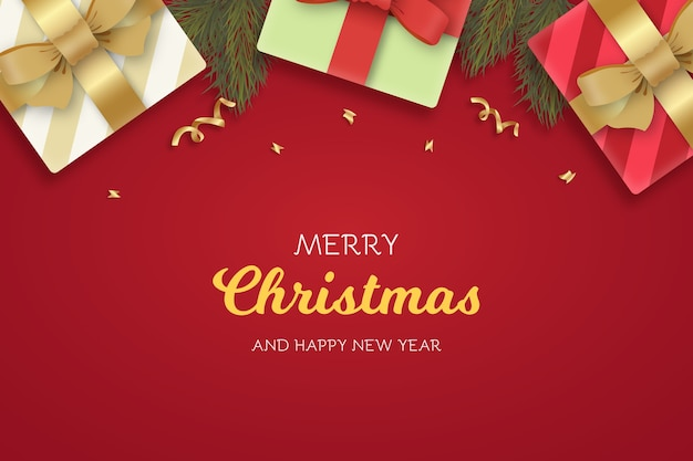 Realistic christmas and new year greeting card with presents and branches