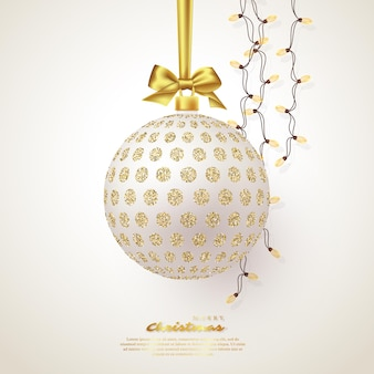 Realistic christmas white bauble with golden bow and garland. decorative elements for christmas holiday background. vector illustration.
