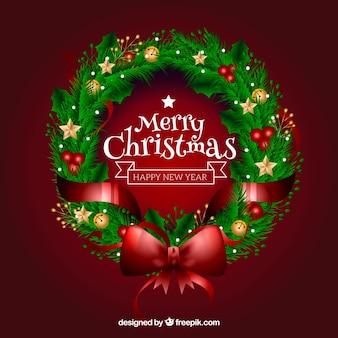 大きな赤い弓で現実的なクリスマスの花輪