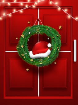 Realistic christmas wreath with illuminated lighting garland hanging on red door.