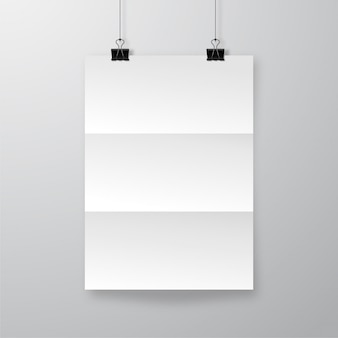 Realistic crumpled paper sheet with shadow. wrinkled poster hanging on bulldog clips   template.