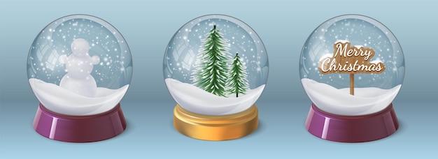 雪だるまとクリスマスツリーのリアルなクリスタルスノーボール。冬の休日の装飾が施されたガラスグローブ球。 3dクリスマススノードームベクトルセット。今のところ雪が降る光沢のあるおもちゃ
