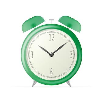 リアルな卓上時計。白い背景で隔離の緑のレトロな目覚まし時計。