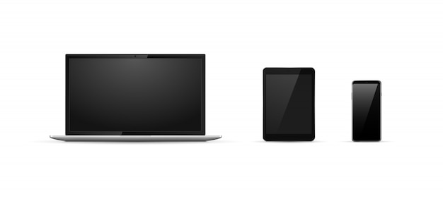Realistic device set. laptop, tablet and phone