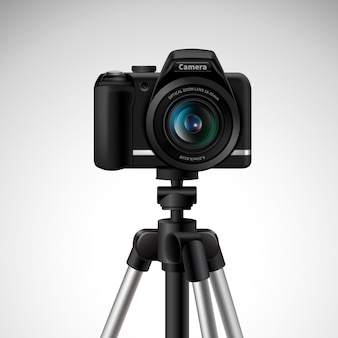 Realistic digital photo camera on tripod