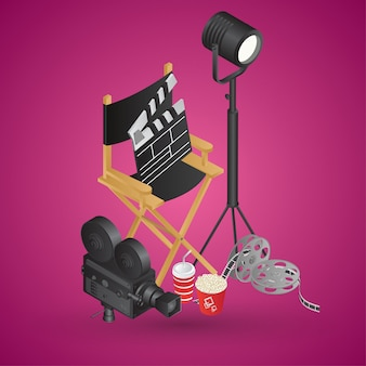 Realistic director chair with video camera, film reel, soft drink and popcorn bucket on pink