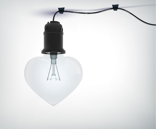 Realistic electric bulb amourous concept in shape of heart with power cord on gray  isolated