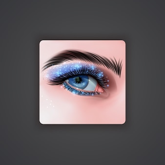 Realistic eyes with bright eyeshadows of blue color with glittering texture