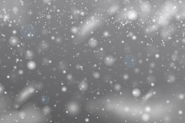 リアルな降雪または雪片。雪が降る冬の風景。クリスマスの降雪。嵐の雲、空、大雪、雪片と雪の結晶の背景