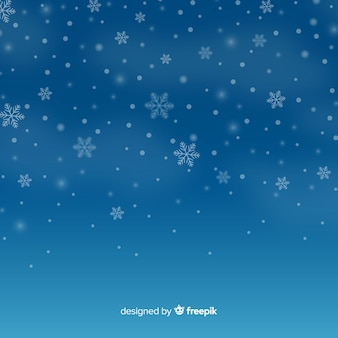 Realistic falling snowflakes in sky background