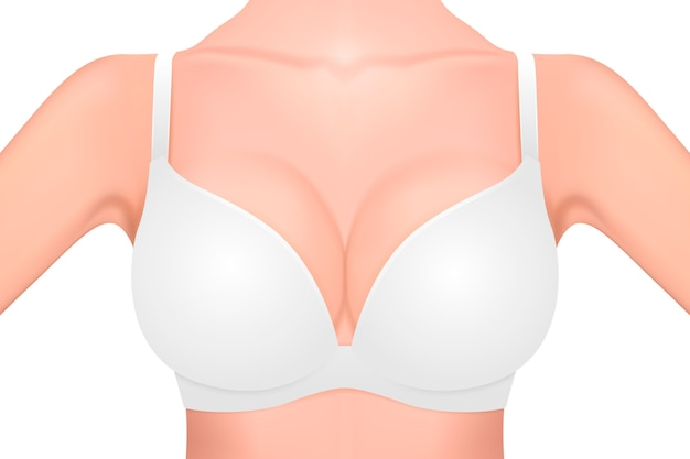 Realistic female breast in a white bra close-up isolated