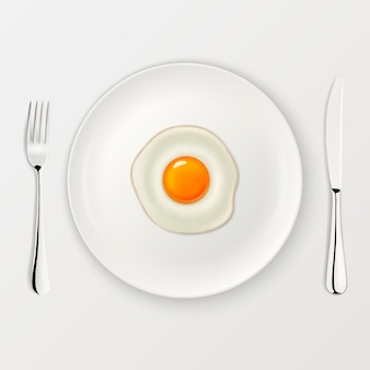 Realistic  fried egg icon on a plate with fork and knife.  template.
