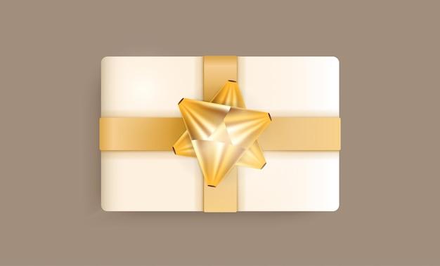 Реалистичная подарочная коробка цвета шампанского, золотыми лентами и бантом. векторная иллюстрация. актуальные цвета.