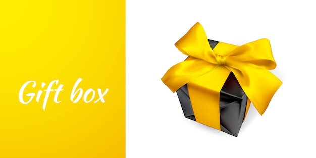 白で隔離される黄色の弓と現実的なギフトボックス