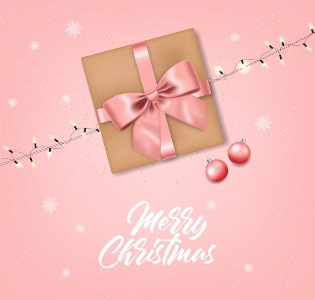 弓とボールの分離、ピンクの背景、クリスマスライト、メリークリスマス、お祝いイラストのリアルなギフト
