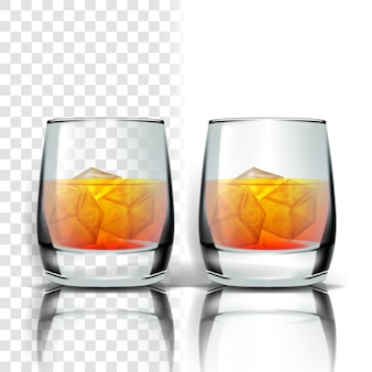 Realistic glass with whisky and ice cubes