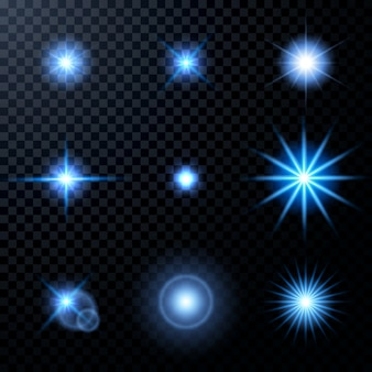 Realistic glowing sparkles particles effects set on dark transparent grid