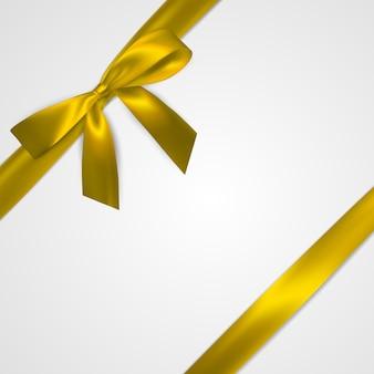 白で隔離黄色のリボンとリアルな金色の弓