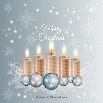 Realistic golden candles on a silver background